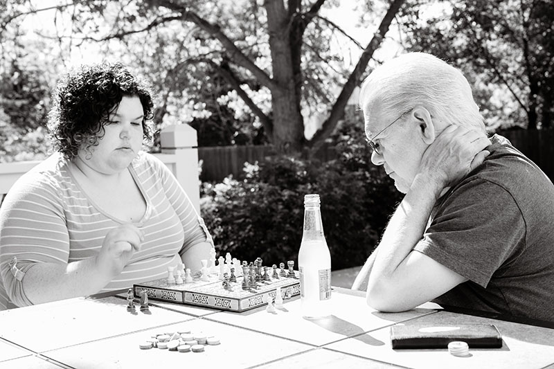 dad and daughter playing chess