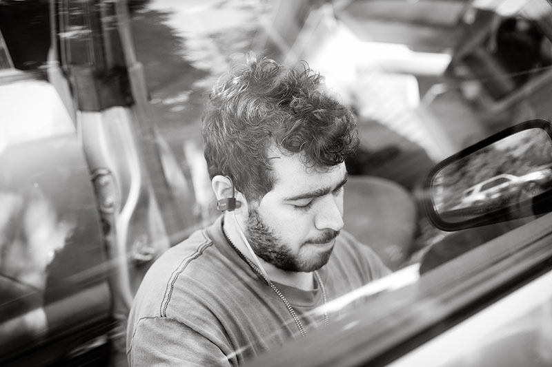 man fixing car portrait