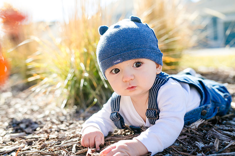 baby outside in a hat photography