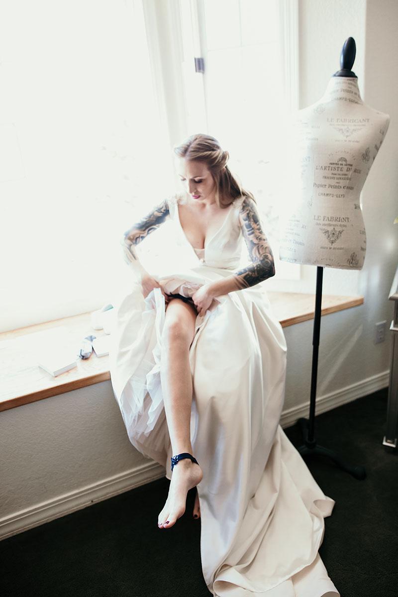 Bride putting on garter at wedding